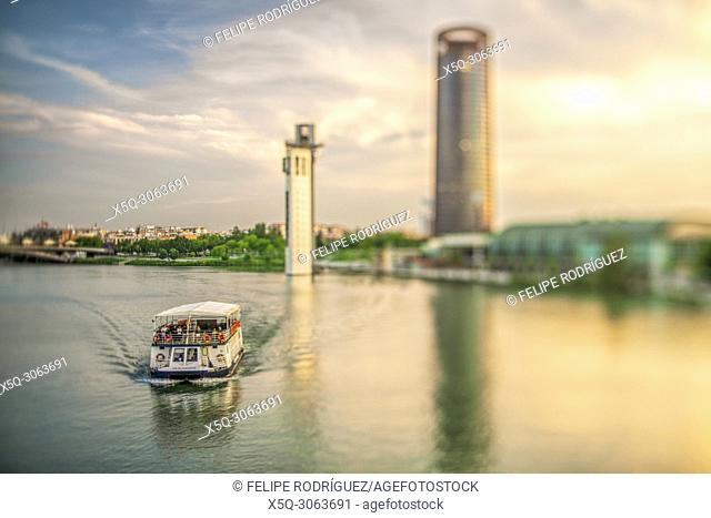 Guadalquivir River Boat Cruise In Seville, Spain. Schlinder and Sevilla Towers on the background. Selective focus through a tilted lens