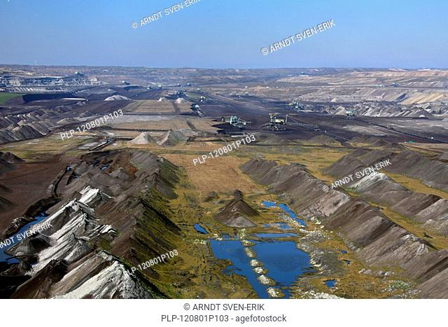 Spoil heaps and brown coal / lignite being extracted by huge bucket-wheel excavators at open-pit mine, Saxony-Anhalt, Germany