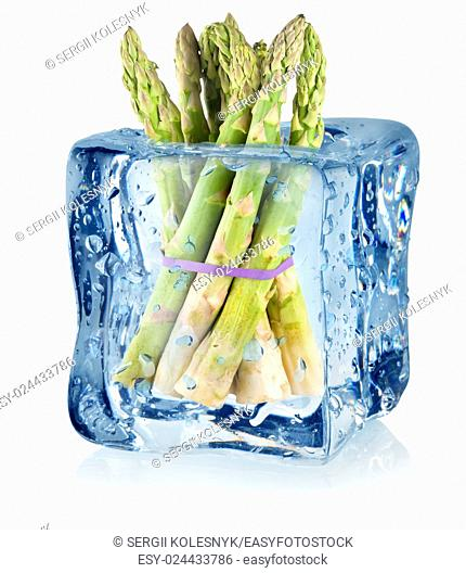 Ice cube and asparagus isolated on a white background