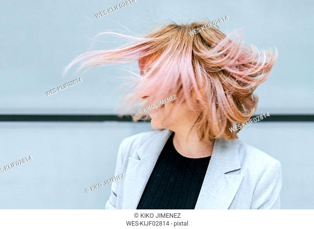 Woman moving her pink hair