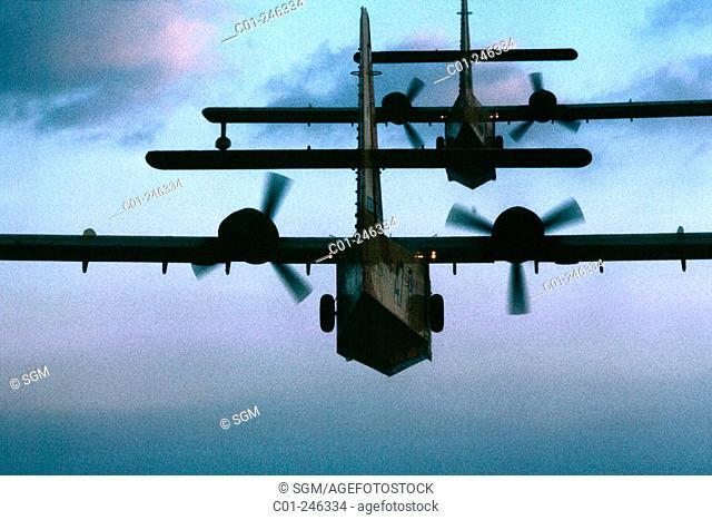 'Canadair' water bombers in flight at dusk