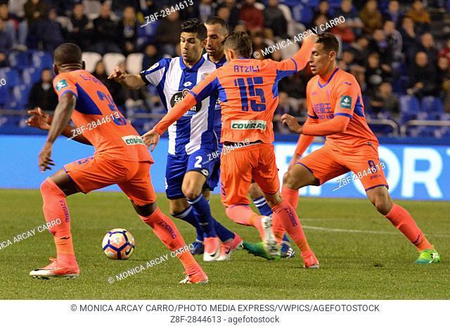 Juanfran against three Granada players. La Liga Santander matchday 30 game between R. C Deportivo and Granada C. F. Riazor, Stadium, la Coruna, Spain