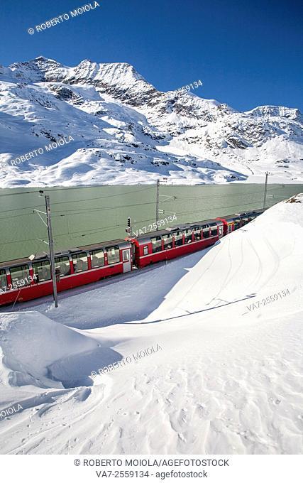 Bernina Express train passes around Lake Bianco St. Moritz Engadine Switzerland Europe