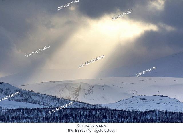 sunrays from hole in clouds, Norway, Troms, Kvaloeya, Tromsoe