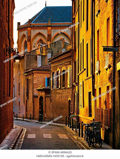 France, Haute Garonne, Toulouse, vertical view of buildings in the Rue Perigord at sunrise