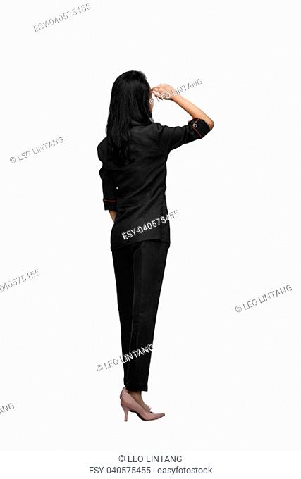 Rear view of asian business woman looking up isolated over white background