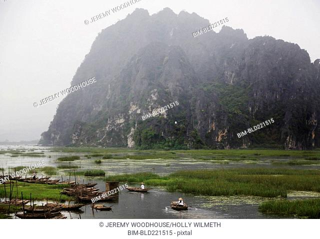 Mountains over canoes in remote marsh
