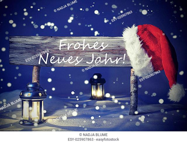 Vintage Wooden Christmas Sign And Santa Hat With Snow. German Text Frohes Neues Jahr Means Happy New Year For Seasons Greetings