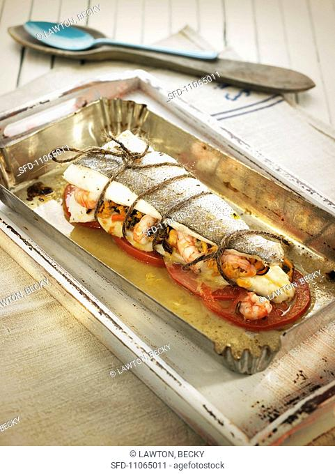 Baked hake filled with seafood Spain