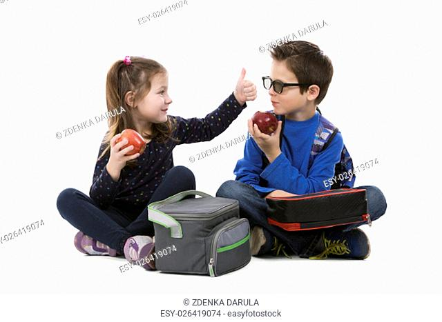 school children having their lunch on white isolated background