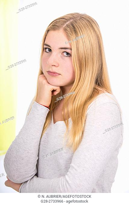 young girl, 15 year old, looking unhappy and cross