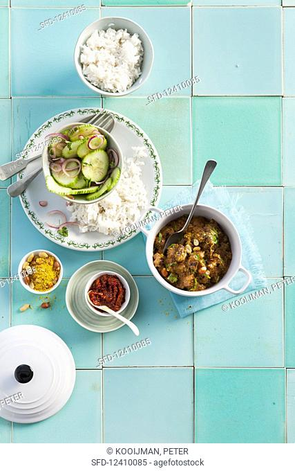Beef stew with peanuts, rice and cucumber salad
