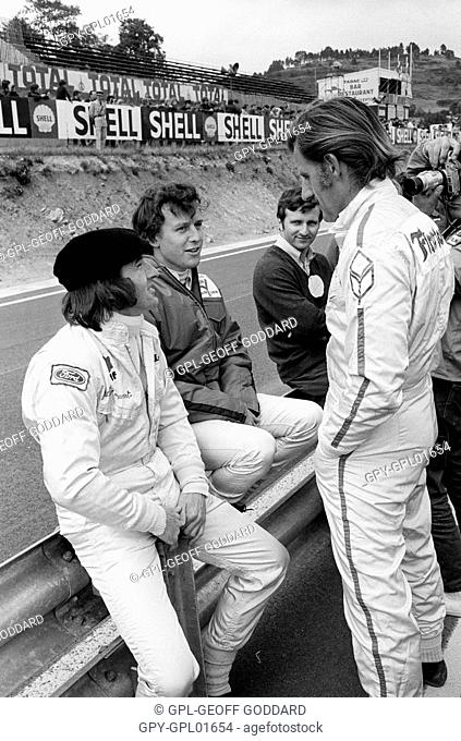 Jackie Stewart with Jackie Oliver and Graham Hill in the Clermont-Ferrand pits. French GP, France 5 July 1970