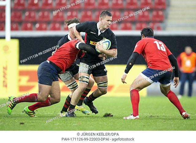 Germany's Max Reinhard (4) in action against Chile's Jose Ignacio Larenas (13) during the rugby international match between Germany and Chile in Offenbach