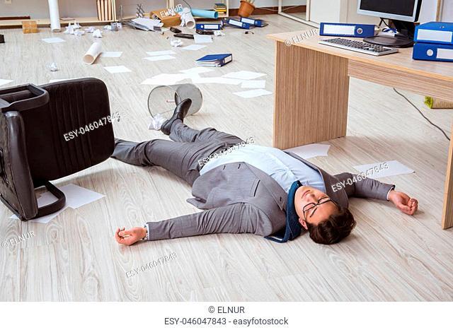 Businessman dead on the office floor