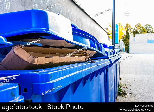 Overflowing Paper Recycling Storage Bin Dumpster Row Multiple Outdoors Corner Closeup Detail Blue Outdoors Daytime Public