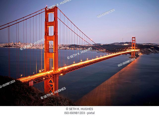 View of traffic light trails crossing Golden Gate Bridge at dusk, San Francisco, California, USA