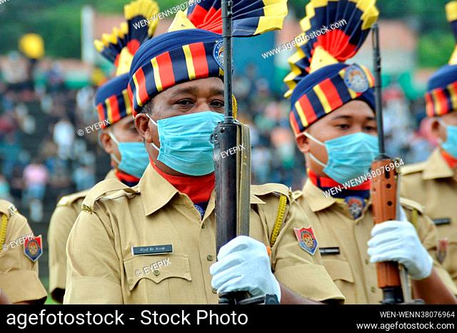 NAGAON, INDIA - AUGUST 15: Police officers take part in a military parade for the Indian Prime Minister, Narendra Modi, during the celebration of the 75th...