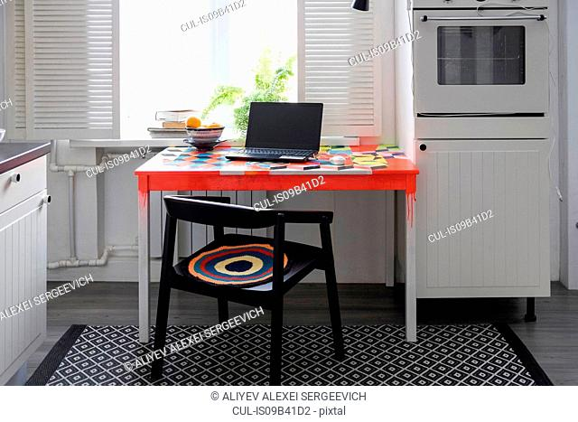 Kitchen with laptop on table