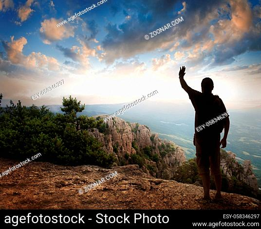 Silhouette of tourist and a beautiful landscape as a backdrop