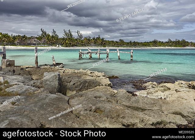 View of the Xpu-Ha beach in the Mayan Riviera in Mexico, on a cloudy day: A magnificent panorama typical of Caribbean beaches