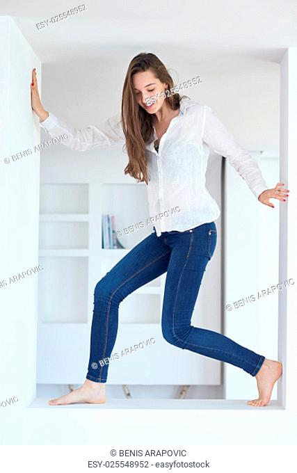 portrait of happy young beautiful woman at home