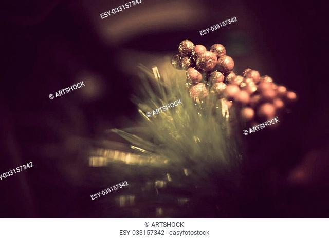 Christmas background with fake red berries on fir tree branch