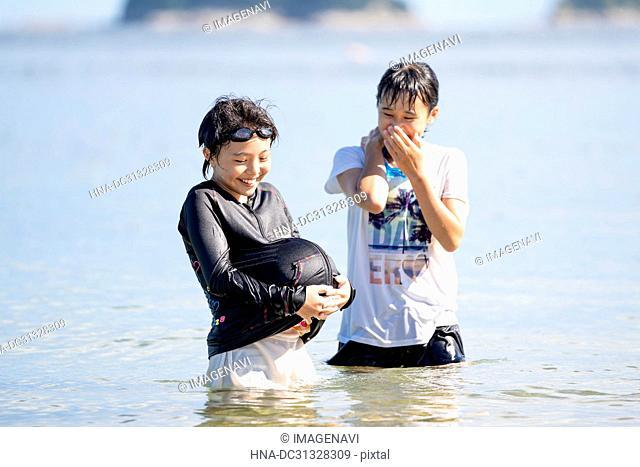 Girls Swimming in Beach