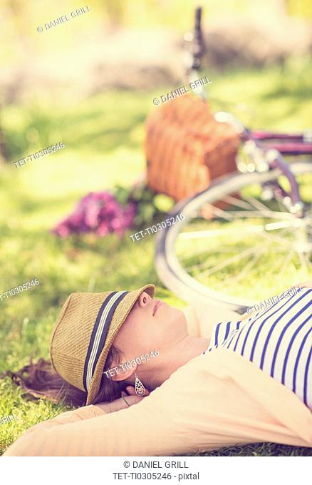 Portrait of mid adult woman relaxing in park