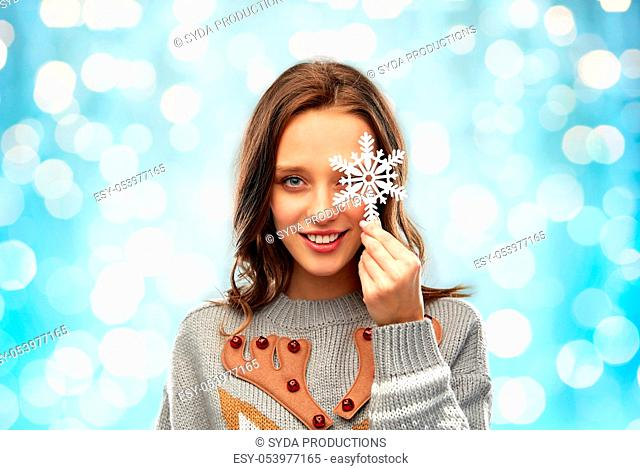 woman in christmas sweater with snowflake