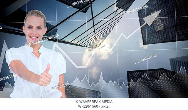 Businesswoman showing thumbs up against graph and buildings