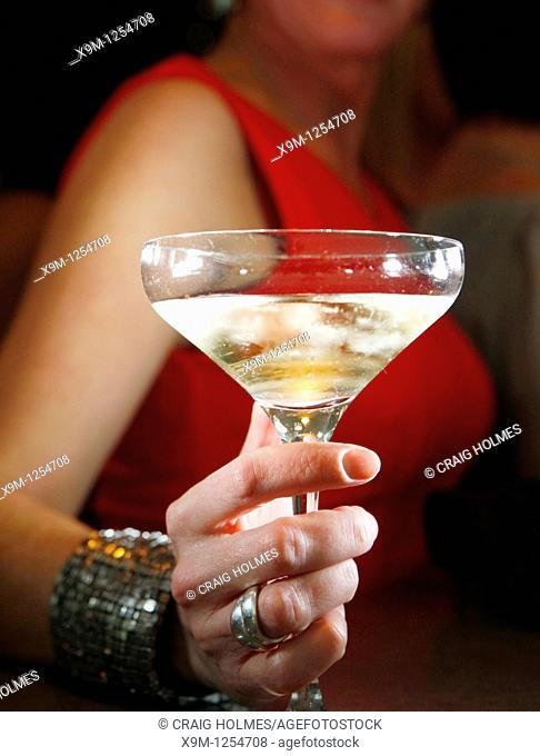 Woman drinking champagne in a bar