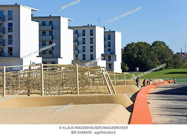 Social housing, climbing frame, children's playground, former fairgrounds, railroad cover, Westend, Munich, Bavaria, Germany, Europe