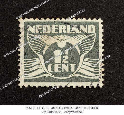 HOLLAND - CIRCA 1940: Stamp printed in the Netherlands shows a drawing with it's value, circa 1940