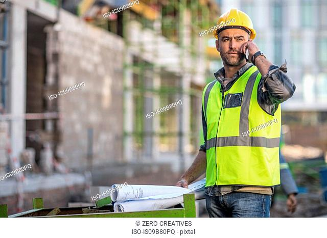 Construction worker using mobile