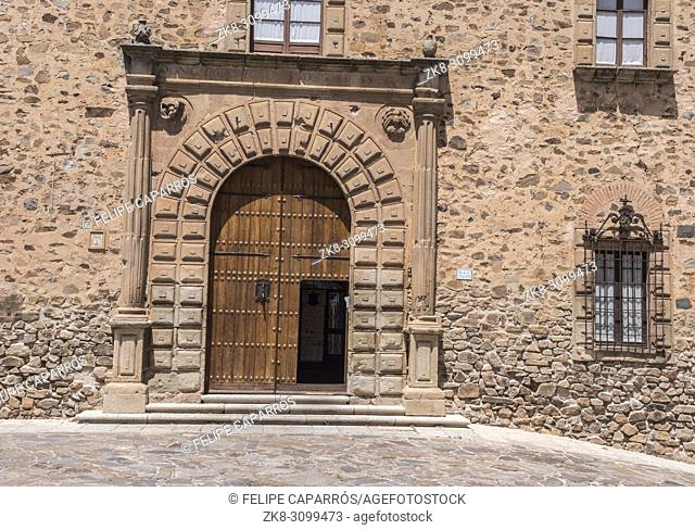 Caceres, Spain - july 13, 2018: Episcopal Palace located in Plaza Santa Maria, main façade, Renaissance style, has a half-point arch pontoon adorned by a double...