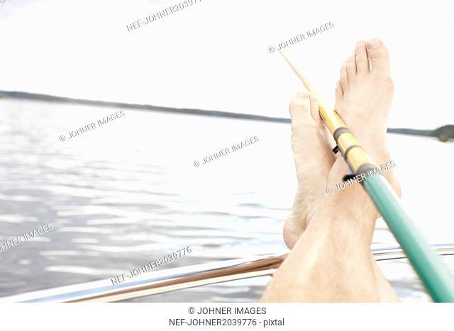 Feet and fishing rod