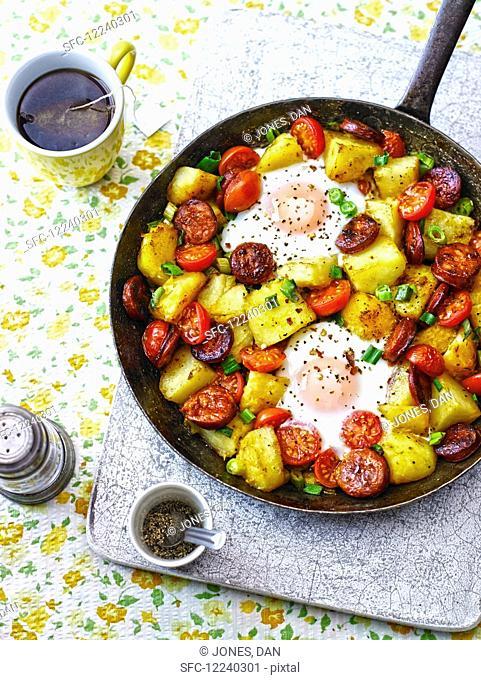 Baked eggs, chorizo, potatoes and tomatoes