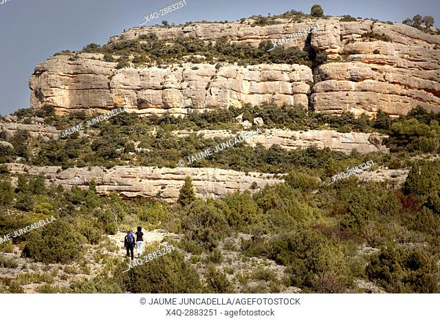 Two people make mountaineering in the Penya Galera way near Beceite village in Los Ports Mountains
