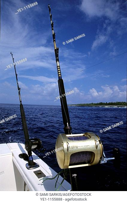 Two fishing rods on a boat near the island of Efate, Vanuatu