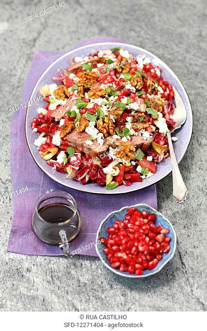Radicchio salad with beets, roastbeef, pomegranate, feta and caramelized walnuts