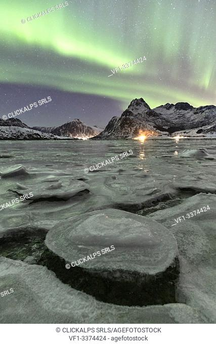 A magical night whit Aurora borealis around Flakstad beach, Lofoten Islands, Northern Norway, Europe
