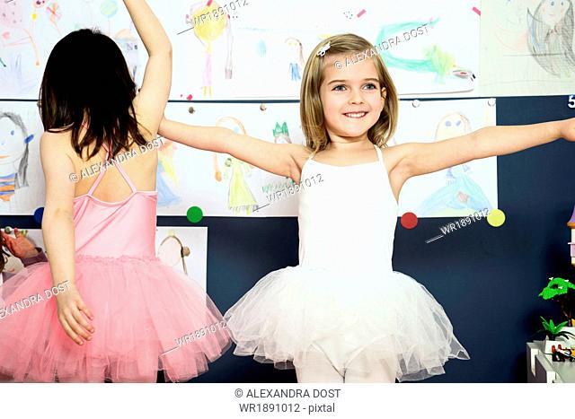 Two girls wearing ballerina dresses