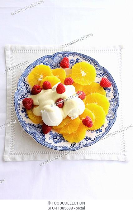 Orange salad with vanilla ice cream and orange cream