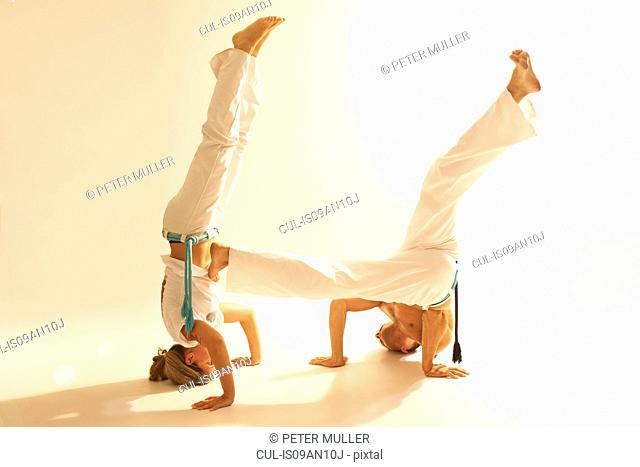 Mid adult couple practising capoeira