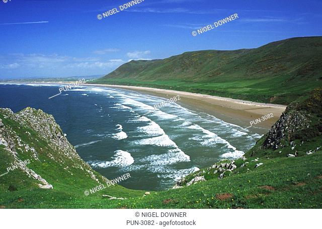 Scenic view across the bay and rolling waves on a sunny day in spring