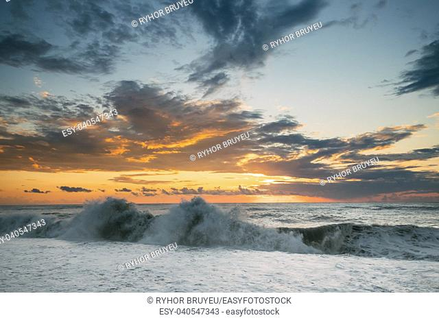 Sea Or Ocean Waves During Storm Colorful Sunset Or Sunrise Sky Background