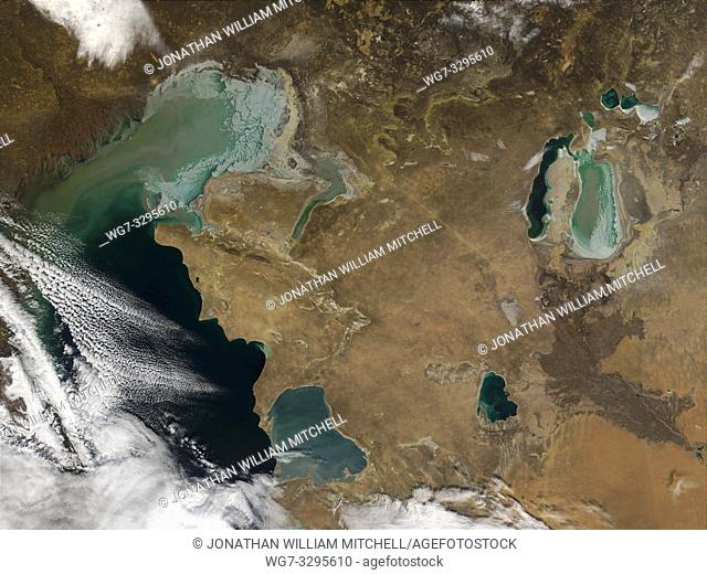 EARTH Central Asia -- 03 Dec 2001 -- In thisimage winter sea ice can be seen forming in the shallow waters of the northern Caspian (left) and Aral (upper right)...