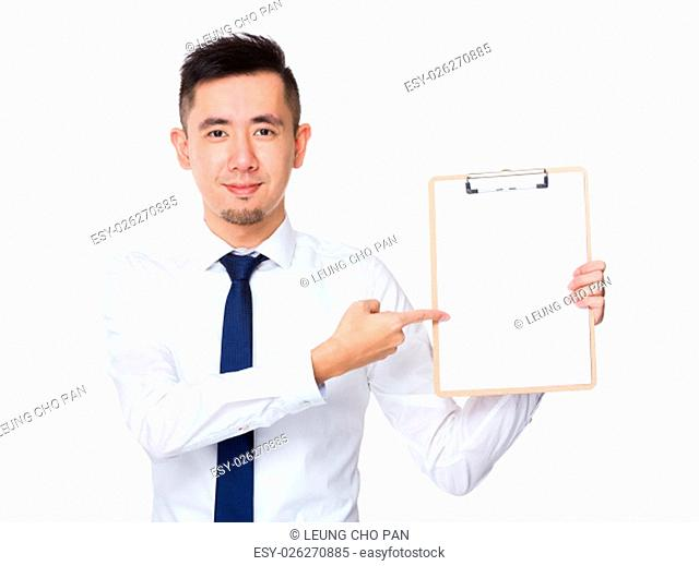 Businessman pen point to clipboard