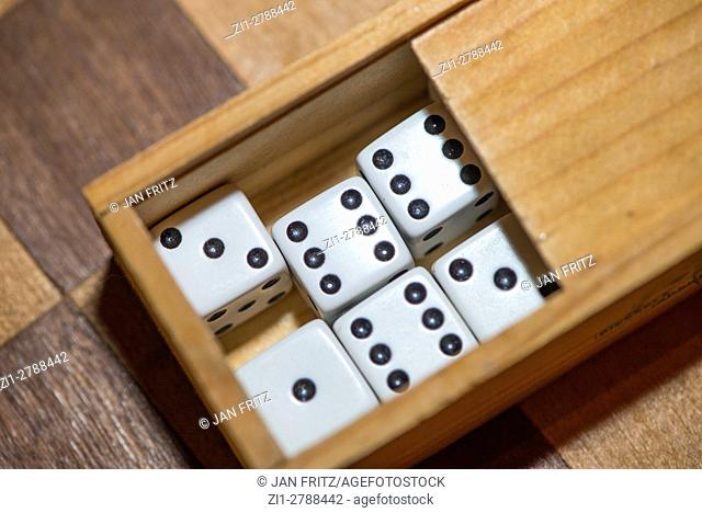 Dices in wooden box